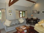 Large and spacious living room with 2 large sofas , a beautiful antique oak table