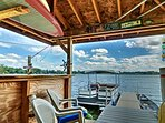 Spend lazy afternoons at the tiki bar or out on the private dock during your stay at this lakefront Waterford Township...