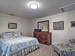 The third bedroom features a queen-sized bed and large wooden dresser ready to host your entire wardrobe.