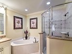 Soak your cares away in the master bath's deep tub.