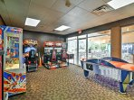 Give the kids some coins to go crazy in the arcade room.