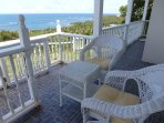 Seagrapeheights cottage porch awaits you!