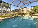 Soak up the Florida sun by the home's gorgeous enclosed private pool.