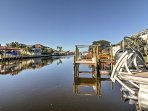 You'll love this home's prime waterfront location on a canal with private dock and boat lift!