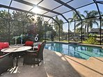 Enjoy serene views of dolphins and manatees in the water while lounging next to the pool!
