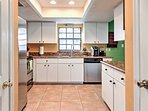 This bright kitchen comes fully equipped with all the essential cooking appliances!