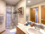 Walk-in shower and bathroom has entrance from bedroom and entrance hallway