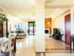 open plan living room area of 165 sq. m with HDTV, fireplace & exit to veranda