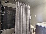 This full bathroom features a shower/tub combo and luxurious shower head.