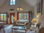 Look out of large glass windows to wooded views from the comfort of the living room.