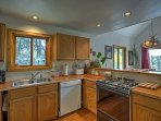 You'll love preparing meals in the spacious kitchen, as it hosts modern appliances, a double sink, and ample