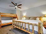 The second master bedroom offers a king bed and a twin-over-full bunk bed.