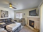 The living room hosts a cozy gas fireplace, flat-screen TV and comfy couches for relaxing.