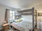 The second bedroom offers a twin-over-queen bunk bed.