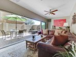 Downstairs family room that features a flat screen TV and extra large multi sliding arcadia doors that open up to the...