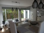 Patio doors onto terrace and garden with chill out area seating