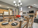 Gather friends around the 8-person dining table to enjoy a home-cooked meal.