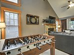 This home features a Foosball table and dartboard for friendly competitions each evening.