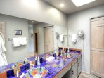 Master Ensuite Bathroom - The master bathroom features two sinks and a water closet with a bathtub/shower combination.