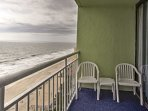 Admire the busy beach below from the private top-floor balcony!