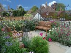 Relax outside in the pretty cottage garden - with a cup of tea or glass of wine?