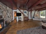 Wood beams, rock fireplace, a very comfortable space