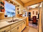Kitchen pass through is also a quaint breakfast bar.