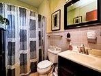 Beautiful full bathroom with tub  shower combination.