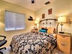 Guest bedroom has a queen size bed.