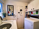 Full laundry room with deck access.