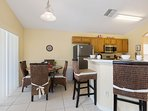 Enjoy a casual dining experience at the table or at the breakfast bar.