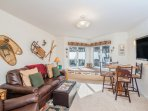 Viking Lodge 315 - the living room has a leather sleeper sofa, flat screen TV, dining table and kitchenette.