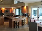 A view of the kitchen and casual dining spaces. Kitchen appliances were recently installed
