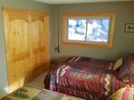 Extra bedroom view w/ knotty pine decor.
