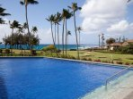 Gorgeous pool overlooks the beach - just a few steps from the condo