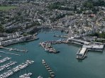 A birds eye view of bustling Brixham Harbour. The second largest fishing port in England.