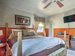 The master bedroom offers a four-poster bed with queen-sized mattress.