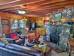 This home features warm wood-paneled ceilings and a rock fireplace.