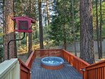 Surround yourself with towering pine trees as you soak in the hot tub.