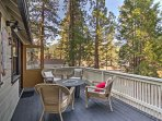 Enjoy sprawling forest views with friends and family from this private deck.