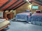 The loft offers additional sleeping space with 2 twin beds and a futon.