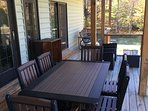 Outside seating rear deck overlooks pond
