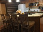 Cook meals in our updated kitchen while visiting with family. The island has seating for four.