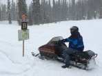 Enjoy snowmobiling. There are 130 miles of groomed snowmobile trials accessible from our cabin.