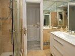En suite bathroom off Master bedroom - walk in shower, WC, bidet.  Towels and pool towels provided.