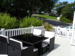 Large terrace with outdoor seating and BBQ facilities