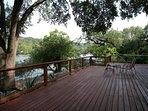 Huge deck overlooking Lake Austin under shade from Oak tree