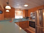 The kitchen features a brand new fridge and plenty of counter space!