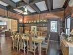 The unique wooden walls create a beautiful and inviting atmosphere in the dining room.