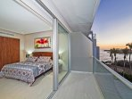 Queen size bedroom with private bathroom and ocean view terrace